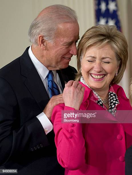 S Vice President Joseh Biden left and Secretary of State Hillary Clinton share a laugh during a signing ceremony for the Lilly Ledbetter Fair Pay...