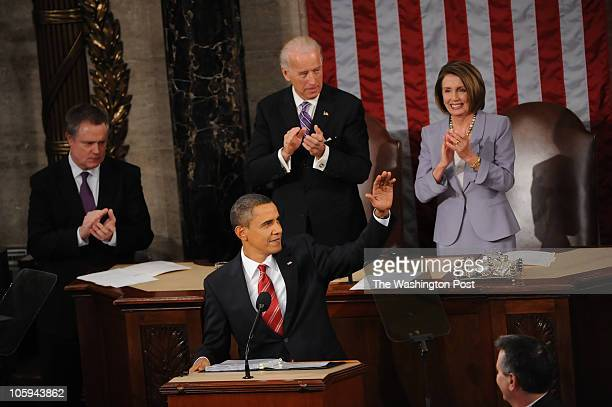 Vice President Joseph Biden and House Speaker Nancy Pelosi behind the President Barack Obama as he takes the podium to deliver his State of the Union...
