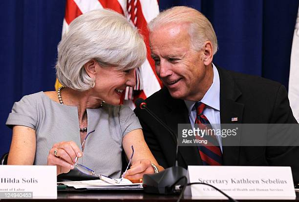 S Vice President Joseph Biden and Secretary of Health and Human Services Kathleen Sebelius speak during a cabinet meeting at the Eisenhower Executive...