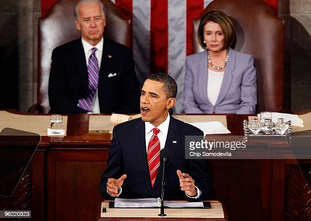 S Vice President Joseph Biden and US Speaker of the House Rep Nancy Pelosi look on as US President Barack Obama speeks to both houses of Congress...