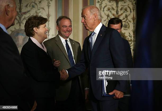 S Vice President Joseph Biden arrives at a meeting with Senate Foreign Relations Committee members as he is welcomed by Sen Ben Cardin Sen Jeanne...