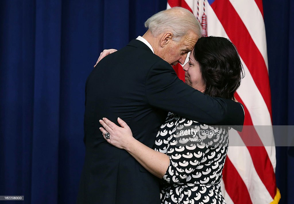 U.S. Vice President Joseph Biden hugs Angela Miller, widow of fallen Pennsylvania State Trooper Joshua D. Miller, before posthumously awarding him with the Medal of Valor, during an event in Eisenhower Office Building, February 20, 2013 in Washington, DC. Vice President Biden presented the award to public safety officers who have exhibited exceptional courage, regardless of personal safety, in the attempt to save or protect others from harm.