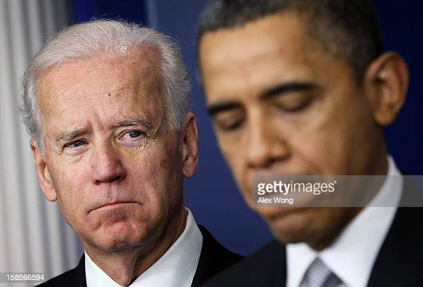 Vice President Joseph Biden listens as U.S. President Barack Obama speaks during an announcement on gun reform in the Brady Press Briefing Room of...