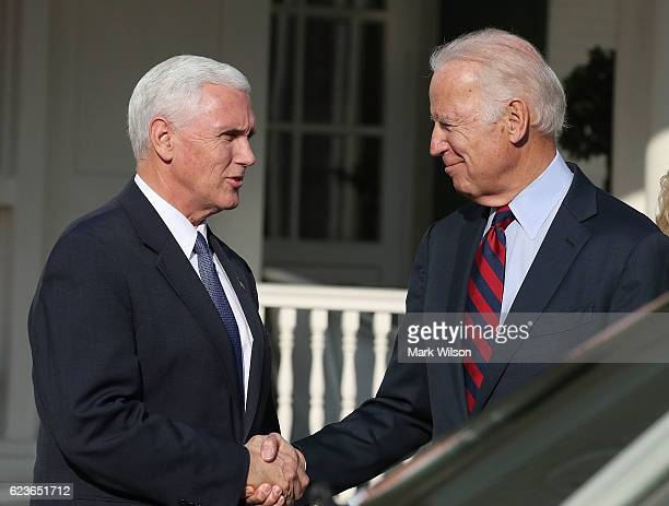 Vice President Joseph Biden shakes hands with Vice Presidentelect Mike Pence at the Naval Observatory on November 16 2016 in Washington DC Vice...