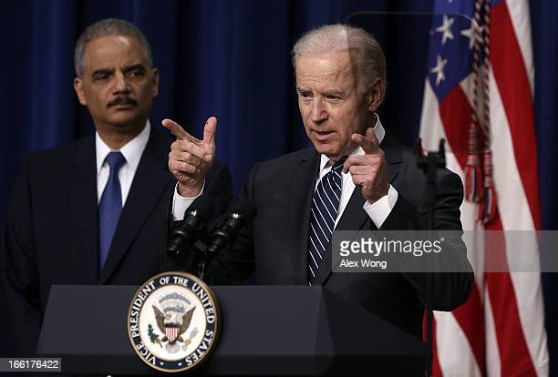 S Vice President Joseph Biden speaks as Attorney General Eric Holder listens during an event on gun control at the South Court Auditorium in the...