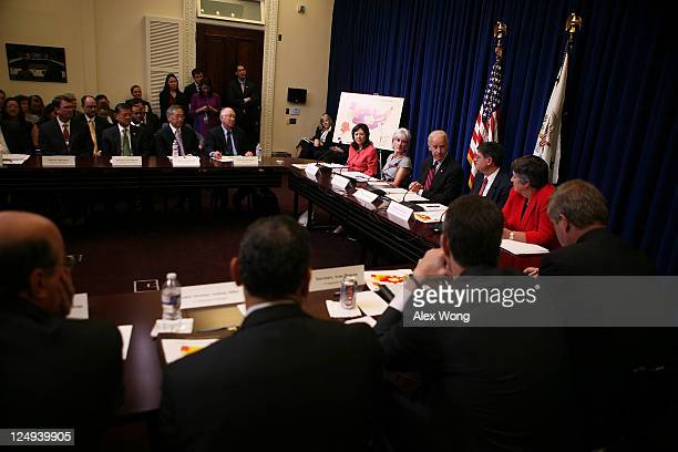 S Vice President Joseph Biden speaks as Office of Personnel Management Director John Berry Secretary of Veterans Affairs Eric Shinseki Secretary of...