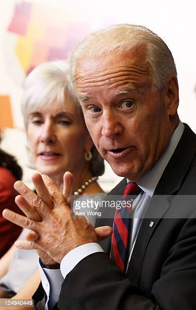 S Vice President Joseph Biden speaks as Secretary of Health and Human Services Kathleen Sebelius listens during a cabinet meeting at the Eisenhower...