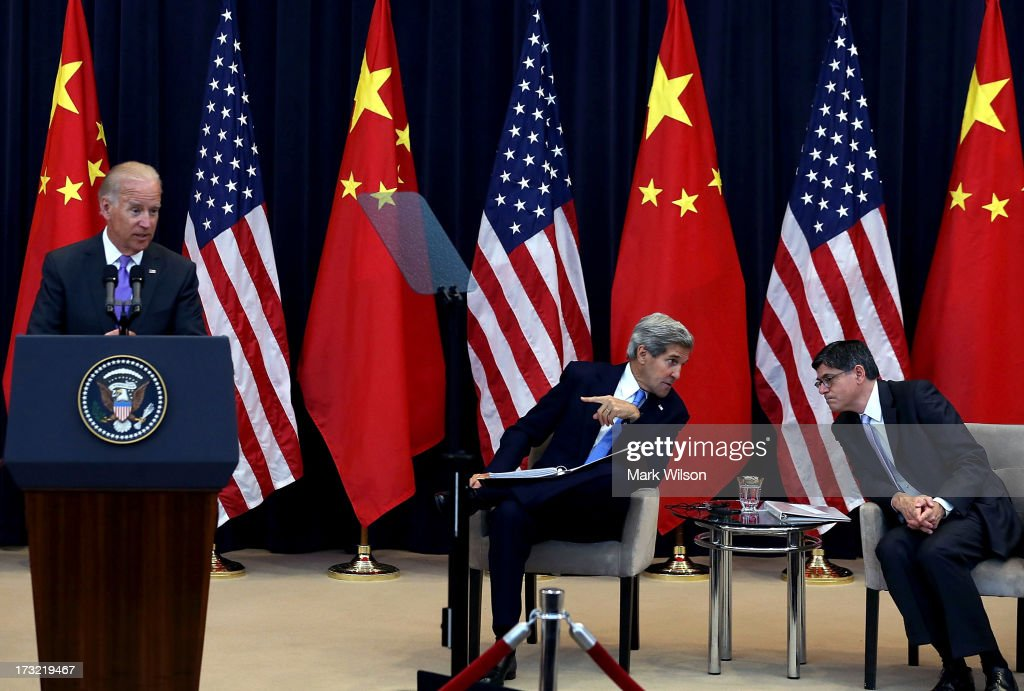 U.S. Vice President Joseph Biden (L) speaks as U.S. Secretary of State John Kerry (2nd-R) and U.S. Secretary of the Treasury Jack Lew (R) listen during the opening session of the U.S. and China Strategic and Economic Dialogue at the U.S. Department of State July 10, 2013 in Washington, DC. Officials from the United States and China are meeting in Washington for the 5th U.S. and China Strategic and Economic Dialogue.