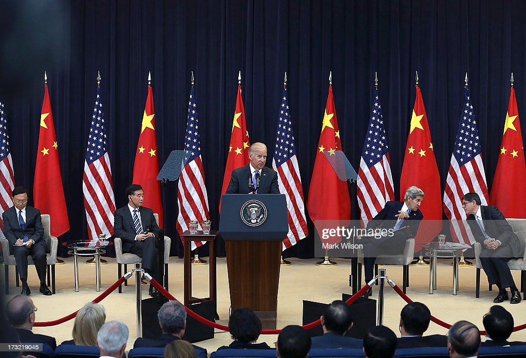 U.S. Vice President Joseph Biden (C), speaks while Chinese State Councilor Yang Jiechi (L), Chinese Vice Premier Wang Qishan (2nd-L), U.S. Secretary of State John Kerry (2nd-R) and U.S. Secretary of the Treasury Jack Lew (R) listen during the opening session of the US and China Strategic and Economic Dialogue at the US Department of State July 10, 2013 in Washington, DC. Officials from the United States and China are meeting in Washington for the 5th U.S. and China Strategic and Economic Dialogue.
