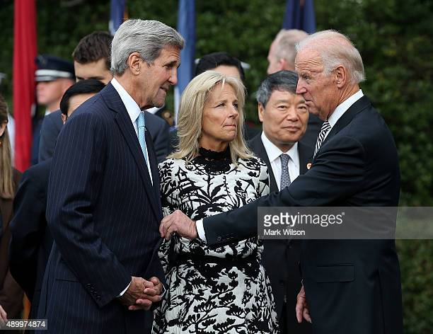 Vice President Joseph Biden talks with US Secretary of State John Kerry as his wife wife Dr Jill Biden listens during an arrival ceremony for Chinese...