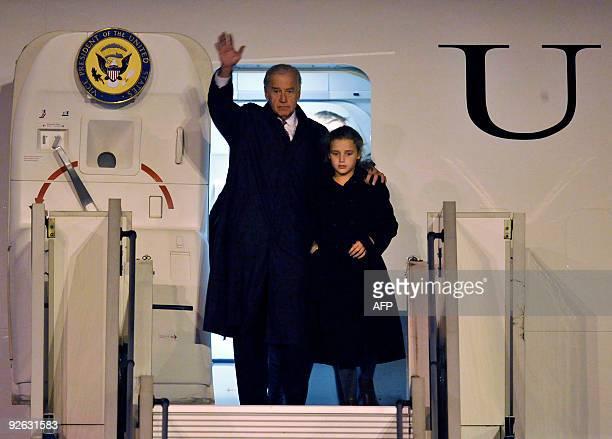 US Vice President Joseph Biden waves with his granddaughter Finnegan James Biden on their arrival at Prague's Ruzyne airport on October 22 2009 Biden...