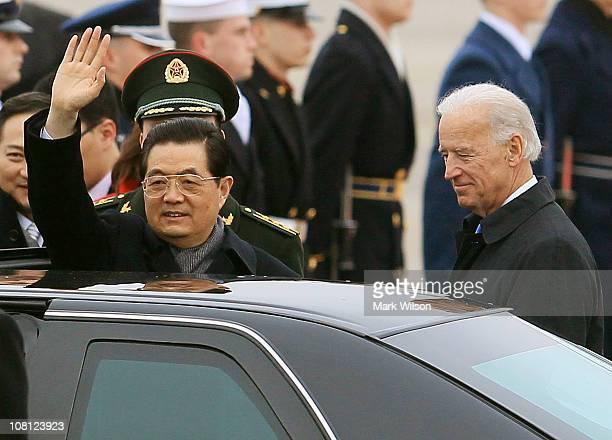 S Vice President Joseph Biden welcomes Chinese President Hu Jintao during an arrival ceremony at Andrews Air Force Base January 18 2011 at Camp...