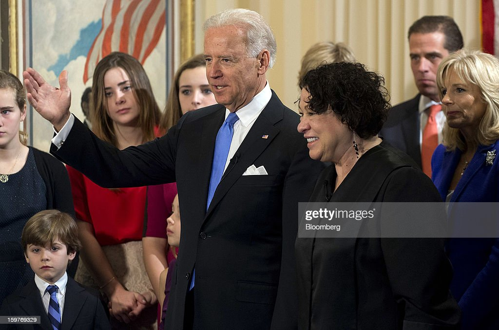 U.S. Vice President Joseph 'Joe' Biden, center, stands alongside U.S. Supreme Court Justice Sonia Sotomayor, as his wife Jill Biden, far right, looks on after taking the oath of office during an official swearing-in ceremony at the Naval Observatory in Washington, D.C., U.S., on Sunday, Jan. 20, 2013. U.S. President Barack Obama is also set to take the oath of office later today surrounded by close friends and advisers in a small ceremony at the White House that will officially begin his second term in office. Photographer: Saul Loeb/Pool via Bloomberg