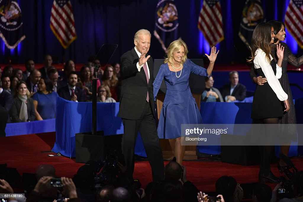 U.S. Vice President Joseph 'Joe' Biden, left, and his wife Jill Biden wave to the crowd after U.S. President Barack Obama's farewell address in Chicago, Illinois, U.S., on Tuesday, Jan. 10, 2017. Obama blasted 'zero-sum' politics as he drew a sharp contrast with his successor in his farewell address Tuesday night, acknowledging that despite his historic election eight years ago his vision for the country will exit the White House with him. Photographer: Christopher Dilts/Bloomberg via Getty Images