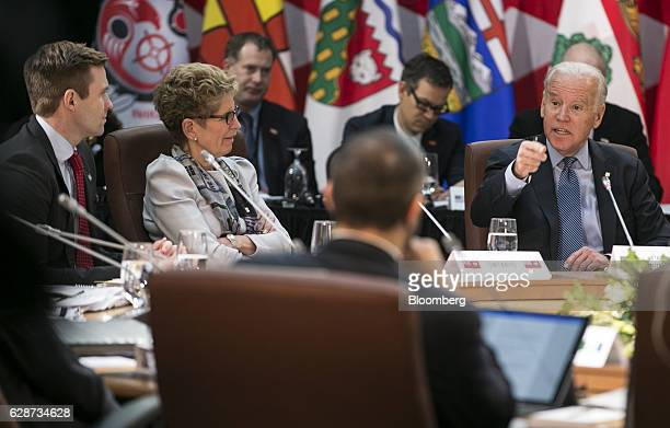 US Vice President Joseph Joe Biden right and Kathleen Wynne premier of Ontario listen during a First Ministers Meeting in Ottawa Ontario Canada on...