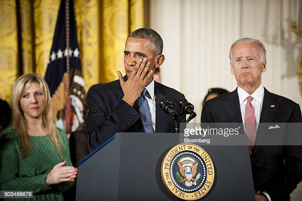 US Vice President Joseph 'Joe' Biden right looks on as President Barack Obama standing with a group of people who were victims of shootings or lost...
