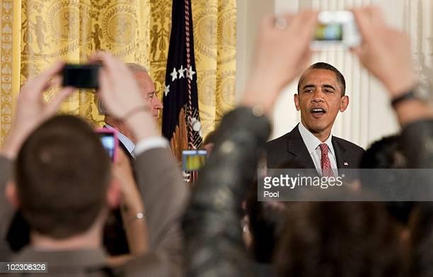 Vice President Joseph R Biden listens to President Barack Obama speaks during an event in the East Room of the White House June 22 2010 in Washington...