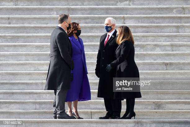 Vice President Kamala Harris and First Gentleman Douglas Emhoff speak with former U.S. Vice President Mike Pence and former Second Lady Karen Pence...