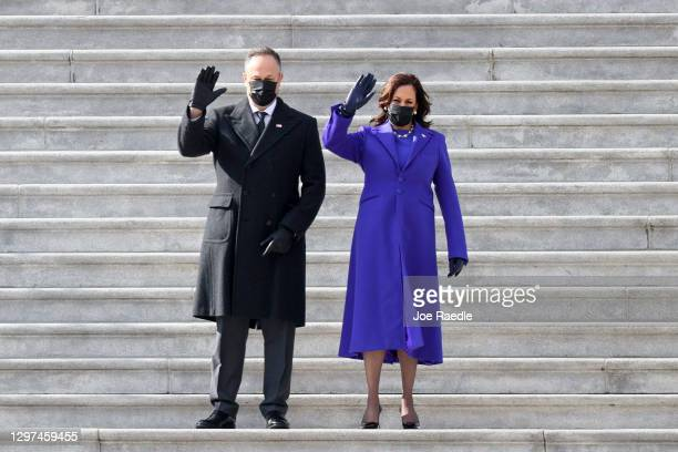 Vice President Kamala Harris and First Gentleman Douglas Emhoff wave to former U.S. Vice President Mike Pence after the inauguration of U.S....