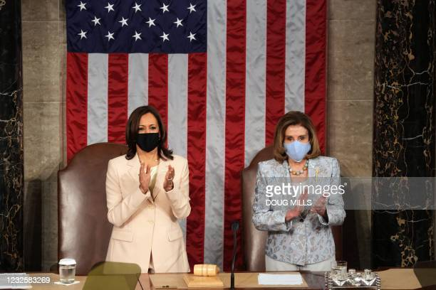 Vice President Kamala Harris and House Speaker Nancy Pelosi clap ahead of US President Joe Biden addressing a joint session of Congress at the US...