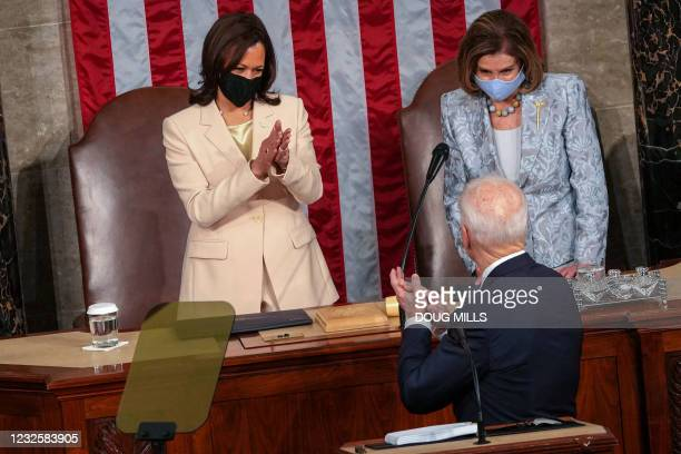 Vice President Kamala Harris and House Speaker Nancy Pelosi welcome US President Joe Biden before he addresses a joint session of Congress at the US...