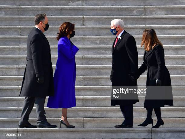 Vice President Kamala Harris and husband Douglas Emhoff exchange words on the east side steps of the U.S. Capitol with former U.S. Vice President...