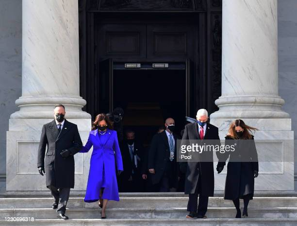 Vice President Kamala Harris and husband Douglas Emhoff walk on the east side steps of the U.S. Capitol with former U.S. Vice President Mike Pence...