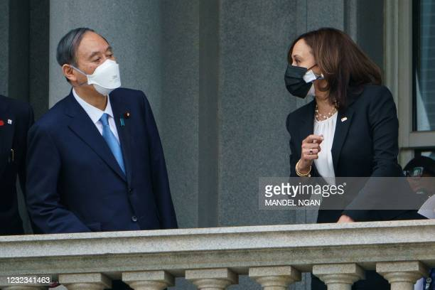 Vice President Kamala Harris and Japanese Prime Minister Yoshihide Suga speak on a balcony ahead of a bilateral meeting in the Ceremonial Office of...