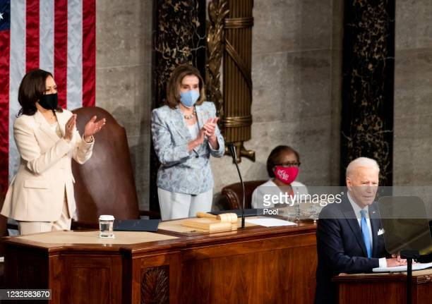 Vice President Kamala Harris and Speaker of the House Nancy Pelosi, clap as President Joe Biden delivers his address to the joint session of Congress...