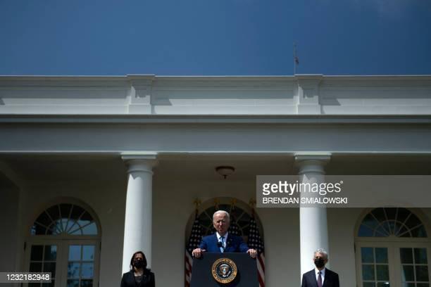 Vice President Kamala Harris and US Attorney General Merrick Garland listen while US President Joe Biden speaks from the Rose Garden of the White...