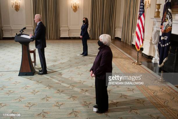 Vice President Kamala Harris and US Secretary of the Treasury Janet Yellen listen while US President Joe Biden speaks about Covid-19 relief from the...