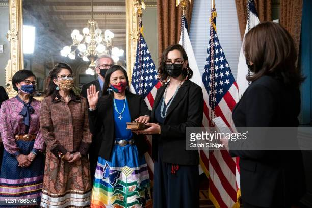 Vice President Kamala Harris conducts the ceremonial swearing in of Secretary of the Interior Deb Haaland as her daughter Somah Haaland holds the...