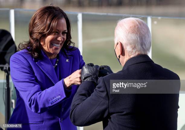 Vice President Kamala Harris fist bumps President-elect Joe Biden after she was sworn in at their inauguration on the West Front of the U.S. Capitol...
