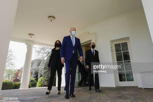 Vice President Kamala Harris, from left, U.S. President Joe Biden and Merrick Garland, U.S. Attorney general, wear protective masks while walking...