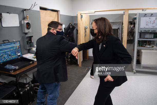 Vice President Kamala Harris greets Eric Batchelor, IBEW Training Director, as she tours the IBEW Training Center in Concord, New Hampshire, April...