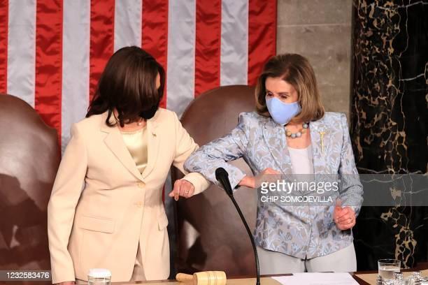 Vice President Kamala Harris greets House Speaker Nancy Pelosi ahead of US President Joe Biden addressing a joint session of Congress at the US...