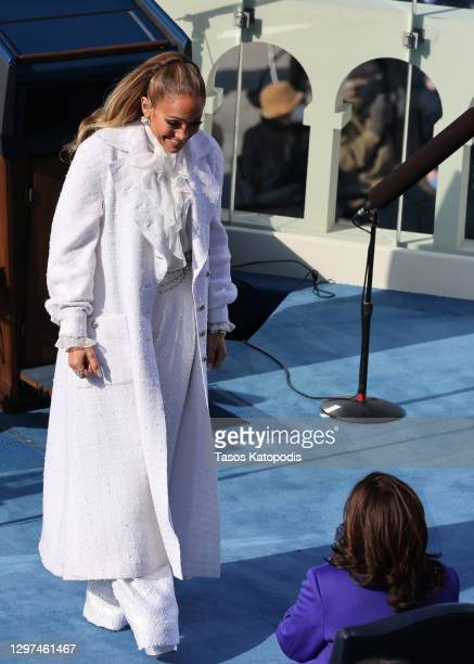 Vice President Kamala Harris greets Jennifer Lopez during the inauguration of President-elect Joe Biden on the West Front of the U.S. Capitol on...