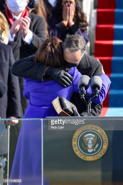 Vice President Kamala Harris hugs his husband Doug Emhoff after being sworn in as Vice President at the inauguration of U.S. President-elect Joe...