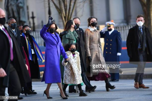Vice President Kamala Harris, husband Doug Emhoff, her great niece Amara, and family members walk the abbreviated parade route after U.S. President...