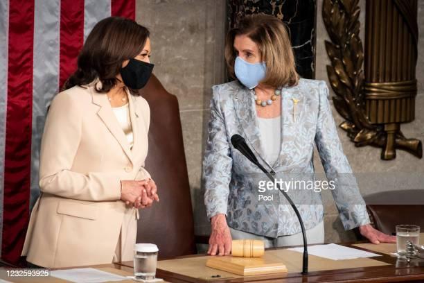 Vice President Kamala Harris, left, and Speaker of the House Nancy Pelosi, D-Calif., talk before the start of President Joe Bidens address to the...