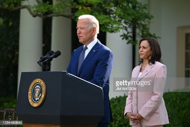 Vice President Kamala Harris listens to US President Joe Biden in the Rose Garden of the White House in Washington, DC, August 5 before he signs a...