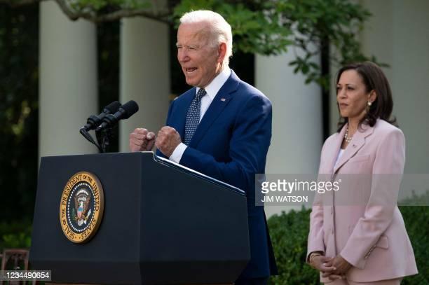 Vice President Kamala Harris listens to US President Joe Biden speak in the Rose Garden of the White House in Washington, DC, August 5 before he...