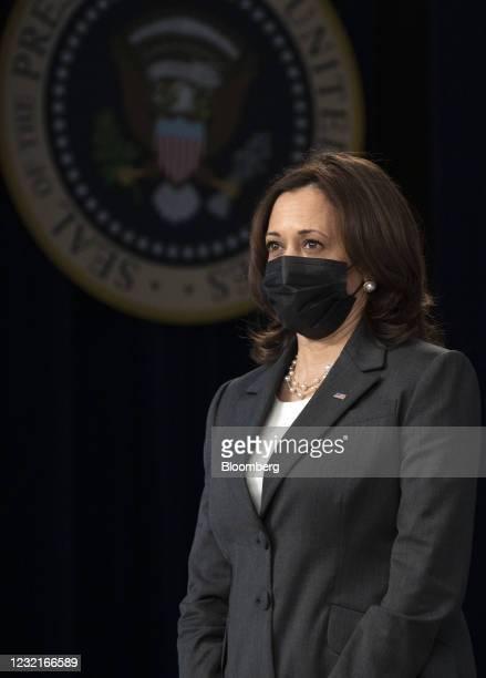 Vice President Kamala Harris listens while U.S. President Joe Biden speaks in the Eisenhower Executive Office Building in Washington, D.C., U.S., on...