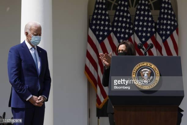 Vice President Kamala Harris, right, claps while greeting U.S. President Joe Biden in the Rose Garden of the White House in Washington, D.C., U.S.,...