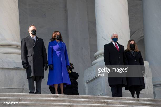 Vice President Kamala Harris, second from left and Second Gentleman Douglas Emhoff, left, send-off former Vice President Mike Pence, second from...
