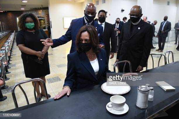 Vice President Kamala Harris sits at a segregated lunch counter where Rosa Parks sat during a visit to the site in the 1990s, as she visits the...