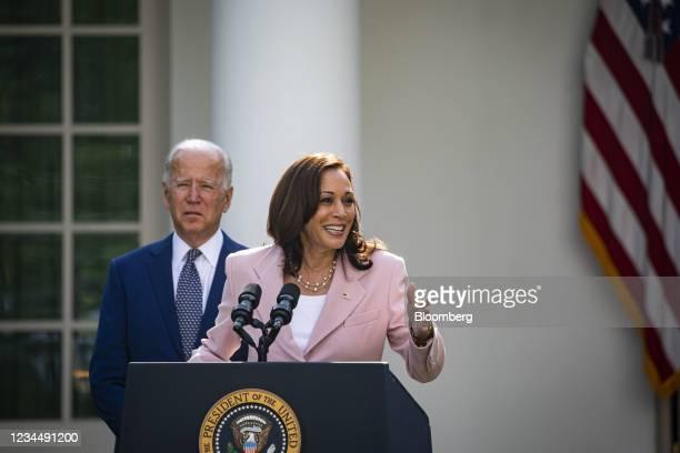 Vice President Kamala Harris speaks as U.S. President Joe Biden listens during a bill signing ceremony in the Rose Garden of the White House in...