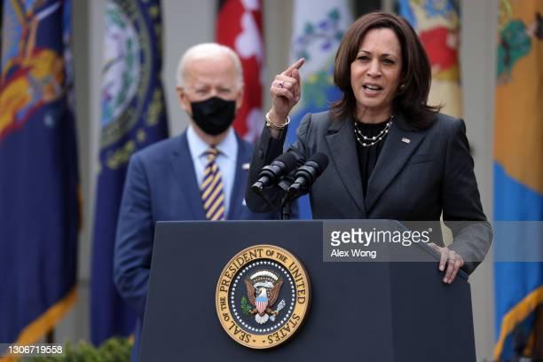 Vice President Kamala Harris speaks as U.S. President Joe Biden listens during an event on the American Rescue Plan in the Rose Garden of the White...