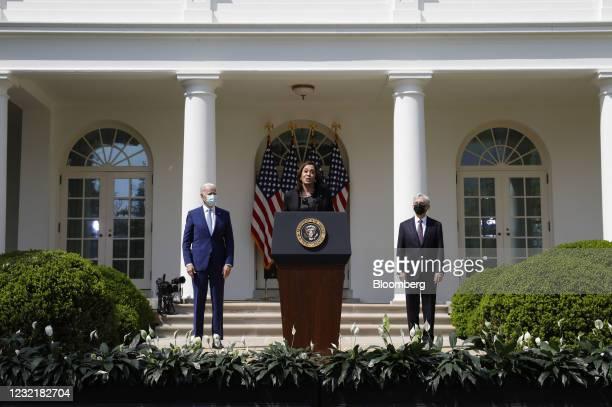 Vice President Kamala Harris speaks as U.S. Vice President Joe Biden, left, and Merrick Garland, U.S. Attorney general, right, listen in the Rose...