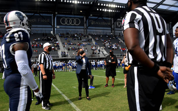Vice President Kamala Harris tosses the coin for the football game between Howard University and Hampton University at Audi Field in Washington, DC,...